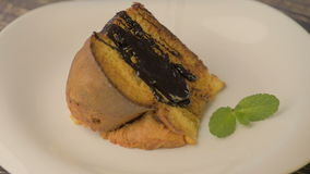 A piece of fresh delicious cake with chocolate stock video