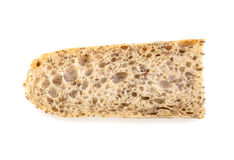 Piece of fresh homemade Alpine Baguette isolated over white. Royalty Free Stock Photos