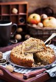 Piece of fresh homemade apple and cinnamon crumb coffee cake. On plate Stock Image