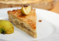 Piece of fresh homemade pear pie Stock Images