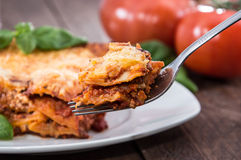 Piece of fresh made Lasagne on a fork Royalty Free Stock Image