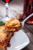 Piece of fresh made Lasagne on a fork Stock Images