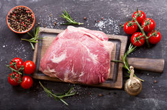 Piece of fresh meat with ingredients for cooking. On wooden board, top view Royalty Free Stock Photos