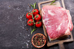 Piece of fresh meat with ingredients for cooking. On wooden board, top view Royalty Free Stock Images