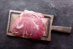 Piece of fresh meat on wooden board Royalty Free Stock Photo