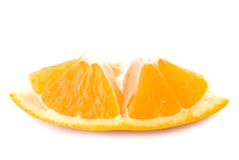 Piece of fresh orange fruit Stock Images