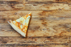 Piece of fresh pizza four cheeses Stock Photography
