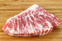 A piece of fresh and raw Beef hump. On a white background Stock Image