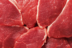 Piece of fresh raw meat. Background Stock Images