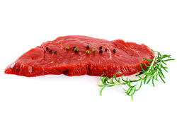 Piece of fresh raw meat with pepper, rosemary Royalty Free Stock Images