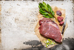 A piece of fresh raw meat with spices . Stock Photos