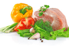Piece of fresh raw meat with vegetables Stock Photos