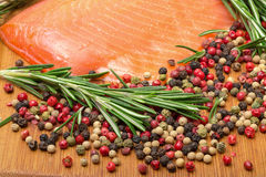 Piece fresh salmon with spices Stock Photo