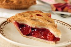Piece of fresh strawberry and rhubarb pie Stock Photography