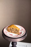 Piece of freshly baked banana cake with walnuts on a dessert plate Royalty Free Stock Photos