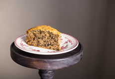 Piece of freshly baked banana cake with walnuts on a dessert plate Stock Image