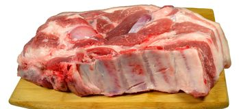 Piece of freshly chopped pork cooked for cooking on a wooden cutting board Stock Images