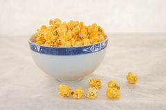 A bunch of freshly popped popcorn. A piece of freshly popped popcorn with cheese on a white background Royalty Free Stock Photos