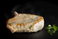 Piece of fried pork meat. On slate background with steam Royalty Free Stock Image