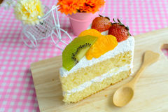 Piece of fruit cake with kiwi,strawberry and orange Stock Image