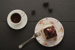 A piece of fruit and a chocolate cake with coffee Stock Photo