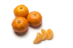 Piece of fruit. Of tangerine with leaves and guys Stock Images