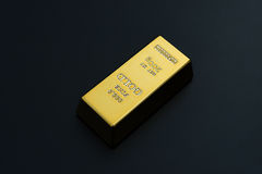 Piece of gold bar on black Royalty Free Stock Photos