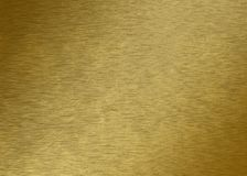Piece of gold - Gold texture - Metal texture - Golden. Texture of a gold piece - macros view with soft lines Royalty Free Stock Image