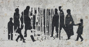 Barcode and People Graffiti on Concrete Stock Image