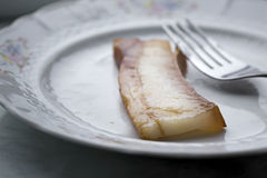 Piece of grilled bacon Stock Images