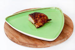 Piece of grilled chicken white meat on a plate Royalty Free Stock Photos