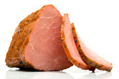 Piece of a ham. With the cut chunks on a white background. Isolated, shallow DOF Stock Photo