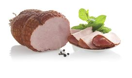 Piece of ham and slices on plate. Isolated on a white background Royalty Free Stock Photo