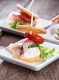 Piece of Ham between two Crackers Stock Image