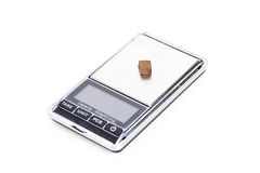 Piece of hashish on digital scales Royalty Free Stock Photos