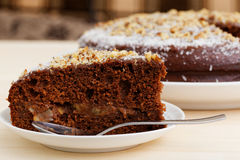 Piece of hocolate cake with walnut and peach Royalty Free Stock Images
