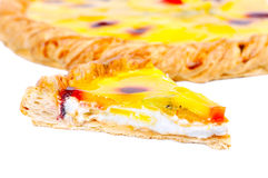 Piece of home-made fruit pizza with pieces of mankind. And the cherry on white background Royalty Free Stock Photos