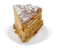 Piece of home made honey cake on plate Stock Photography