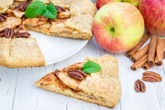 Piece of homemade apple galette with pecan nuts Stock Photos