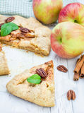 Piece of homemade apple galette with pecan nuts Stock Photo