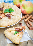 Piece of homemade apple galette with pecan nuts Stock Images