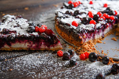 Piece of homemade berry cake on the wood background Royalty Free Stock Photography