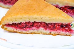 A piece of homemade cake filled with fresh raspberries. A delicious piece of homemade cake filled with fresh raspberries Stock Photo