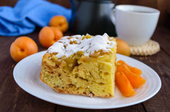 A piece of homemade cake with slices of apple and apricot, decorative powdered sugar Stock Image