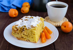 A piece of homemade cake with slices of apple and apricot, decorative powdered sugar Stock Photo