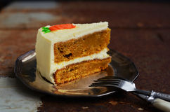 Piece of homemade carrot cake on rustic dark background Royalty Free Stock Image