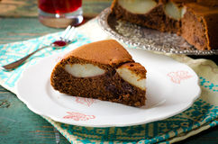 Piece of homemade chocolate cake with pears and chocolate drops Stock Image