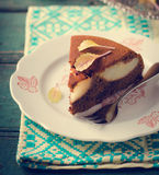 Piece of homemade chocolate cake with pears and chocolate drops Stock Images