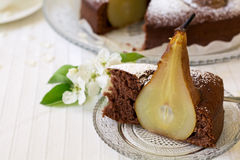 Piece of homemade chocolate cake with pears decorated pear blossom Royalty Free Stock Photos