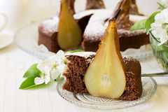 Piece of homemade chocolate cake with pears decorated pear blossom Royalty Free Stock Image